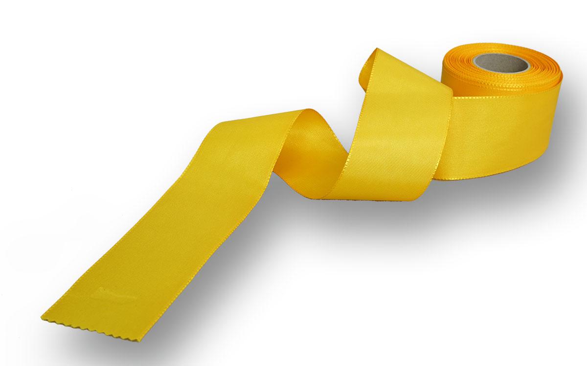 gelbes Ripsband zu Dekorationszwecken