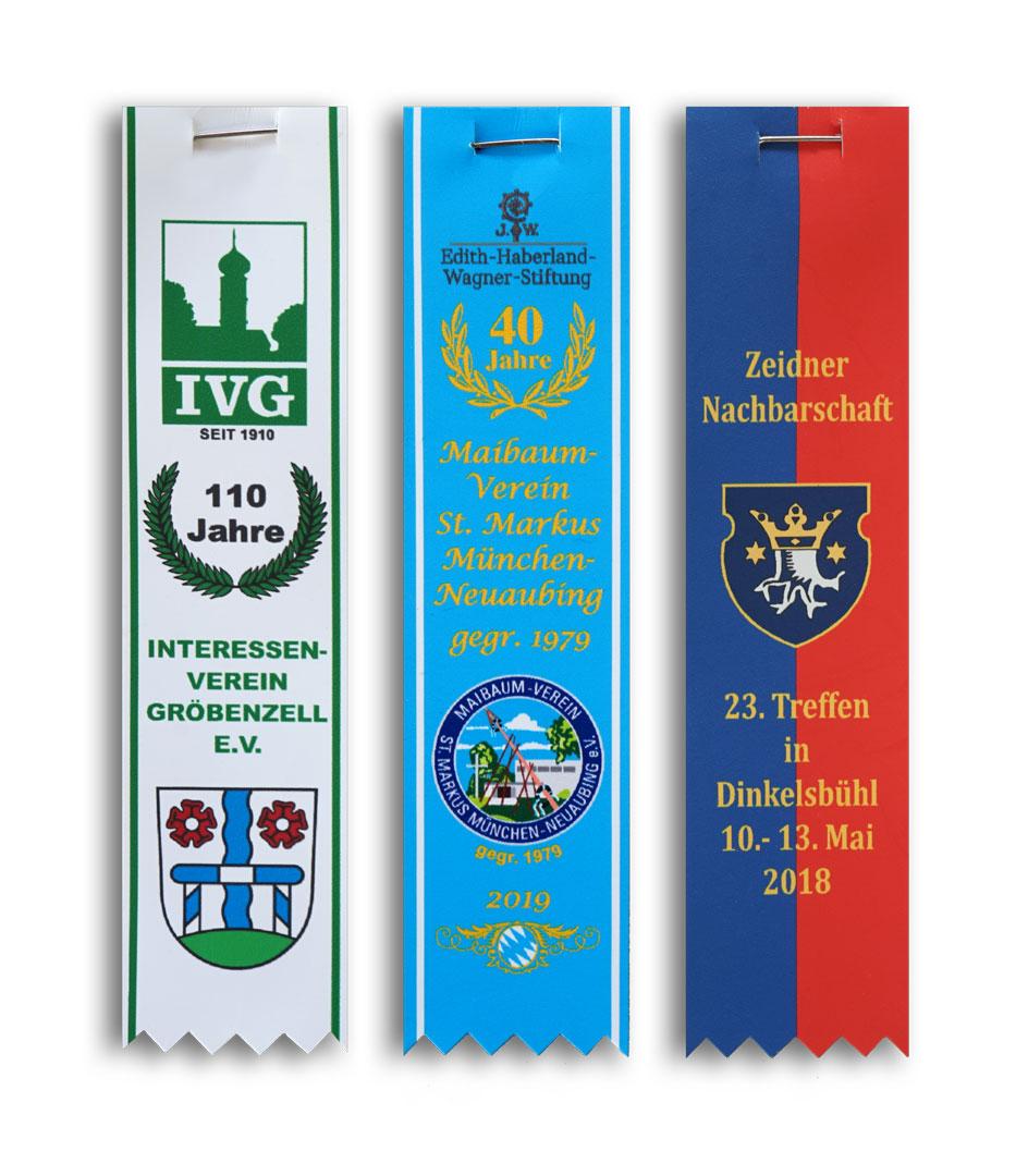 Festabzeichen mehrfarbig bedruckt mit Zackenschnitt und Sicherheitsnadel